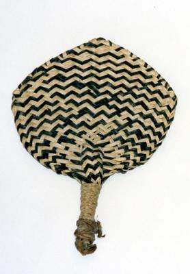 Woven pandanus fan, alternating black and natural strands.