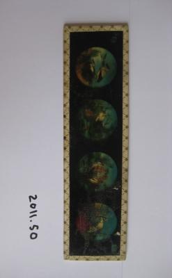 Coloured glass slide of stork cartoon.